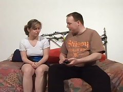 Fat man talking a shy German woman into having dealings with him