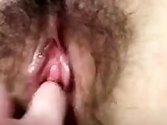 Cute young web cam girl fingering her pussy close up