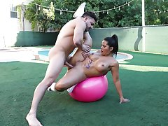 Big-assed Rose Monroe oiled up and fucked outdoors on a yoga bop