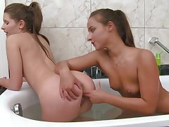 Lesbians quota their love for porn in get under one's warm tub