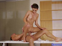 Masseuse Kate Rich gives a table handjob before she's oiled and fucked