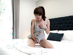 Svelte girl Eva May gets rid of her lacy undergarments to work on wet pussy