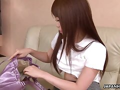 Comely Japanese girls is toying hairy punani spreading legs wide open