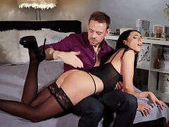 Hot ass brunette Nelly Kent teases with stockings and gets ass fucked
