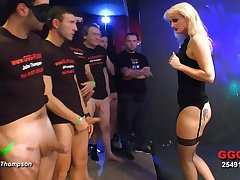 Cock whore in unmentionables takes dick and cum in a gangbang