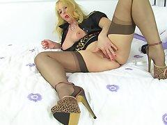 Mature blonde MILF Lucy Gresty strips and masturbates on a fringe