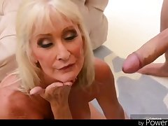 +60 Beamy titted blond hair babe granny still got it