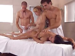 Two masseurs fuck violence hot order about chicks on the massage table and cum on their faces